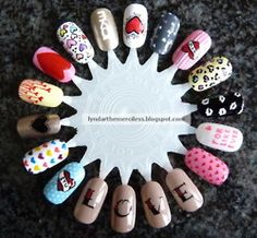 ♥ the LOVE, one letter on each nail idea.  very cute.