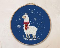 Get creative with these 47 gorgeous winter cross stitch patterns. There's everything from hygge designs to animal cross stitch and more. Cross Stitch Quotes, Cross Stitch Tree, Cross Stitch Heart, Simple Cross Stitch, Llama Christmas, Christmas Animals, Christmas Cross, Christmas Stocking, Modern Cross Stitch Patterns
