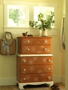 Use ice cream sticks and a white paint pen to create fun floral patterns >> http://www.diynetwork.com/decorating/redo-it-upcycle-dressers-headboards-and-beds/pictures/index.html?soc=pinterest