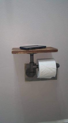 "Industrial Toilet Paper Holder, Farmhouse Toilet Paper Holder, Plumbing Pipe Toilet Paper Holder, Industrial Bathroom, Rustic - with Shelf - Constructed of ½"" iron pipe made from unfinished fittings with a natural gunmetal color. Industrial Toilets, Industrial House, Industrial Farmhouse Decor, Industrial Pipe Shelves, Plumbing Pipe Shelves, Plumbing Pipe Furniture, Shelves With Pipes, Industrial Lamps, Rustic Shelving"