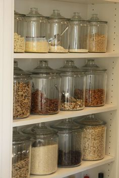Glass jars with scoops for flour, sugar, oatmeal, coffee, baking mix, etc...LOVE the look of this!
