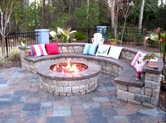 Fire Pit with stone seating. Kyle and I were just talking about doing something like this!
