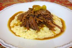 Mississippi Pot Roast ~  Throw the roast in the crock pot, sprinkle with Au Jus mix, Ranch mix, add a stick of butter and some pepperoncini peppers.  That is it!
