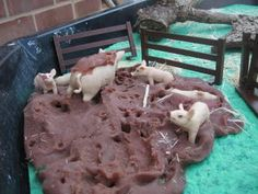 chocolate playdough was made for the mud in this farm sensory table.  Think…
