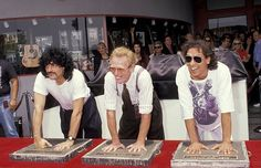 Drummers Carmine Appice, Ginger Baker and Alex Van Halen being inducted to the RockWalk in Hollywood in 1991.