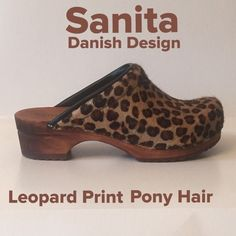 Sanita Wooden Clogs Beautiful Leopard Print Pony Hair Wooden Clogs in excellent condition. Outsole, natural polished wood effect wedge. Non slip tread pattern on bottom. Retails $145. Size 37 (7) Santina Shoes Mules & Clogs