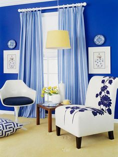 Color Plus White          The easiest way to mix patterns is to stick to one color plus white. The striped panels, floral chair fabric, and geometric floor pillow all stick to the blue-and-white color scheme.