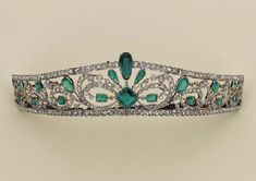 BELLE EPOQUE EMERALD AND DIAMOND TIARA. Tunnel worked with plant motifs set with old cut diamonds and emeralds, one emerald cut octagon, c1900.