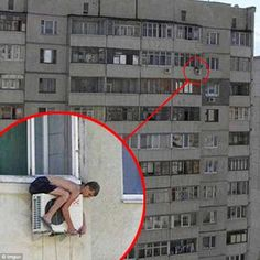 Death wish? Our best guess here is that this chancer is fixing an air conditioning unit, but it's definitely not one to try at home