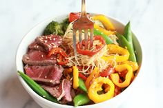 What's better than a bowl filled with delicious veggies?  Try this Asian noodle bowl with grilled steak for your next dinner!
