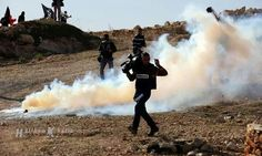 Bil'in Dec.20-13 Protest Gassed on Palestinian Land.