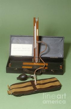 Martin's Improved Sphygmomanometer with its case, dating from 1920. This instrument is made from glass and mercury by S. Maw, Son and Sons. The sphygmomanometer was originally invented by Samuel Siegfried Karl Ritter von Basch in 1881. It was used to measure blood pressure; the cuff (brown) would be placed around the patient's arm whilst the physician placed their finger on the wrist to feel for the radial pulse. The cuff was inflated using the rubber bulb (black) until the pulse could no longer be felt. The level of the mercury in the glass tube (centre) would indicate the pressure in the cuff. The pressure would be released from the cuff slowly and the point at which the radial pulse returned would be read from the level of the mercury and this