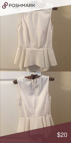 NWOT ELLE Ivory Peplum Shirt, Sz 2 NWOT ELLE brand from Kohl's ivory peplum shirt, size 2. All my items come from a smoke free home. I don't accept trades, but do accept offers! ELLE Tops
