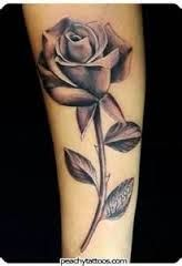 rose with stem tattoo - maybe as a fix to another tattoo