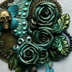Handmade polymer clay roses ... part of my newest Danse Macabre brooch...