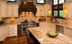 GRANITE: Venetian Gold light polished slab cream background with pale random gold and light brown highlight; also called giallo ornamental, santa cecilia light; ornamental gold; TILE is pretty too