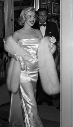Marilyn Monroe - March 4, 1953 - attending the premiere of Call me Madam, a play performed by Ethel Merman, her partner in There's No Business Like Show Business - at the Fox Ritz Theatre, 5214 Wilshire Boulevard, LA - the gown was designed by William Travilla and was accompanied by a white fox stole and white satin gloves Art