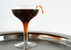 Port o'Call: 1 ounce Guinness 1 1/4 ounce Martell VSOP (or other nice, assertive cognac) 1/2 ounce St-Germain 1/4 ounce crème de cacao 3 dashes Angostura bitters Orange zest, for garnish