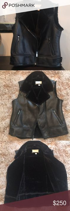 MICHAEL MICHAEL KORS BLACK LEATHER SHEARLNG VEST L Beautiful beautiful Michael Michael Kors Black and shearling vest. This vast was given to me by my son who Had worked directly with Michael Kors. I have only had a chance to wear it once. It is a very warm very stylish very classy vest. MICHAEL Michael Kors Jackets & Coats Vests