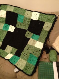 Minecraft Crochet Creeper face blanket by Robin playing with dollies, via Flickr