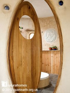 This is Rachel's straw bale home in Wales. It won the Grand Designs eco-house award in 2009. Rachel's home was the first two storey load bearing straw bale home in the UK. See more pictures of here home at www.naturalhomes.org/quietearth.htm