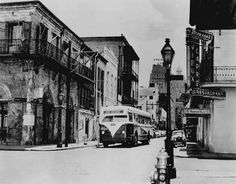The Desire bus stops for a passenger at the corner of Bourbon and Iberville Streets, ca. 1953.