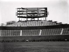 Ivy planted, scoreboard under construction at Wrigley, 1937, Chicago. Will it come down?