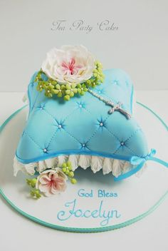 I made this small cake for a friends daughter for her first communion. My young client had drawn a picture of what she wanted and I did my best to recreate it in cake. :) This cake is made using the smallest pillow pan by Wilton. TFL!