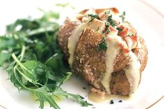 Baked potatoes with bacon and blue cheese filling. A delicious combination especially when good quality blue cheese is chosen