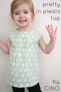A simple top with pleats at front and buttons at back. Would be cute over a long sleeve top in Autumn too.  Pattern making tips and sewing tutorial. #sew #SewforGirls