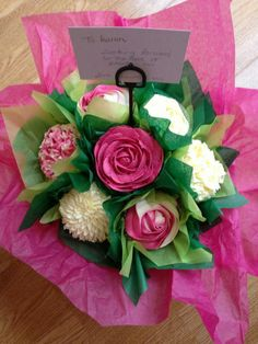 I love the use of tissue paper on this beautiful cupcake bouquet!