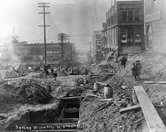 Building Seattle literally meant moving mountains. 1907 Looking west down Spring Street during the first Denny regrade.