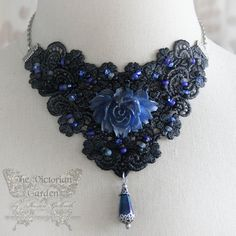 ______________________________________________________________________________ Id rather have roses on my table than diamonds on my neck. ~ Emma Goldman ______________________________________________________________________________ This splendid Victorian inspired choker necklace is so eyecatching and intricate. Ive started with a lovely piece of Venice lace, dying it to a two-tone dark shimmering black with a hint of silver. At center is a large, hand painted sculpted rose in midnight...