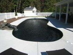 pool with black tiles make so much sense. why use energy to heat up your pool when this would do it for you?  also: pretty