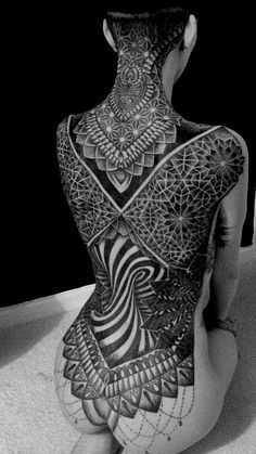 Glenn Curzen http://www.topguntattoo.co.uk/dot-work.html By far the most stunning tattoo I've seen!