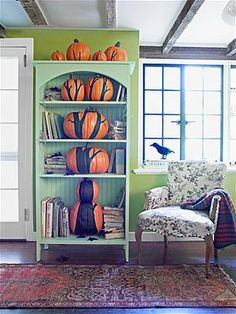 HOW COOL IS THIS?! Painted pumpkin 'tree' bookshelf!  Photo: Dana Gallagher