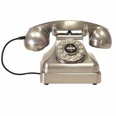 "Retro-inspired corded desk phone with a rotary button dial.     Product: Desk phone    Construction Material: Thermoplastic    Color: Brushed chrome    Features:  Rotary-inspired dial    Tone and pulse switch      Dimensions: 5"" H x 6"" W x 6.25"" D"