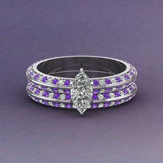 Shop knife edge pave marquise cut diamond wedding set with violet topaz in white gold at Fascinating Diamonds. This diamond engagement ring is designed in Pave setting Most Beautiful Engagement Rings, Diamond Engagement Rings, Jewelry Rings, Jewelry Box, Jewelery, Pink Purple Wedding, Diamond Wedding Sets, Marquise Cut Diamond, Best Diamond