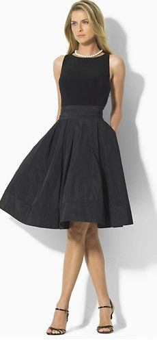 Ralph Lauren ~ Classic little black dress. I have this dress and it is fabulous. Waist is a wrap around with V shaped back. Mine wraps around to tie in front. Could not figure how she tied it in back.