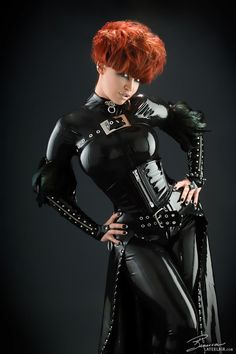 BB in tight shiny black latex