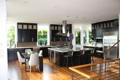 Contemporary kitchen design with sleek black cabinets, steel accents, and a large island. Discovered on www.Porch.com. #kitchens Contemporary Kitchen Cabinets, Contemporary Kitchen Design, Black Cabinets, Kitchen Cabinet Design, California Homes, Dream Rooms, Future House, Pantry, Table