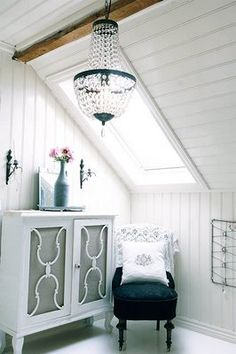 Love this beadboard ceiling with the beam/seam down the middle to break up the white