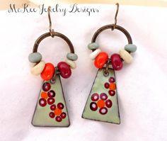 Red, orange, Light blue and copper enameled charm earrings.