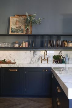 Create a restful colour scheme with dark walls in a kitchen. Whether you choose to match them with your cabinets, or simply opt for a statement wall, don't be afraid to tap into bold and cheerful hues with your paint choices. You really can't beat a deliciously dark kitchen wall.  Image: Farrow & Ball