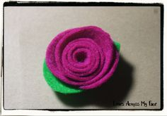 trace a cd on a square of felt...cut into a spiral...hot glue the end...easy!