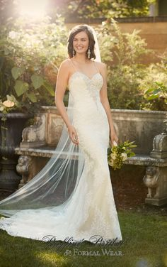 Essense of Australia #D2006 - An elegant dress to remember, this lace over Lavish satin sheath wedding gown from Essense of Australia features Diamante beading on its sweetheart neckline, low back, and sexy spaghetti straps.