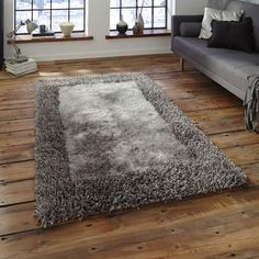 Sable 2 Rugs in Silver is handmade in China with a soft, silky Polyester pile with a contrasting viscose border. #DecorTips #Decor