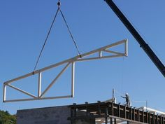 New glulam roof trusses are going into a building at our nearby state university. After we manufactured and fabricated the glulam we assem. Roof Trusses, State University, Utility Pole, Building, Buildings, Construction, Architectural Engineering