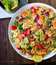 Pasta Primavera with lemon-pepper-tahini dressing and creamy avocado walnut pesto