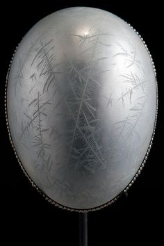 Fabergé The 1914 Nobel Ice Egg by Faberge, made of platinum, silver, translucent white enamel and seed pearls . Within is a miniature watch made of platinum, rose cut diamonds and rock crystal.